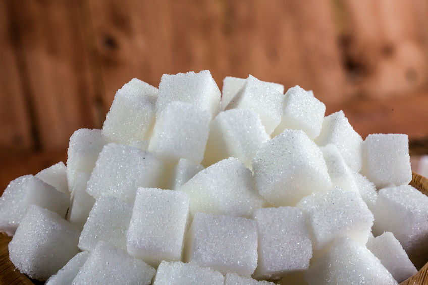 48488851 - pile of sugar cubes over wooden background