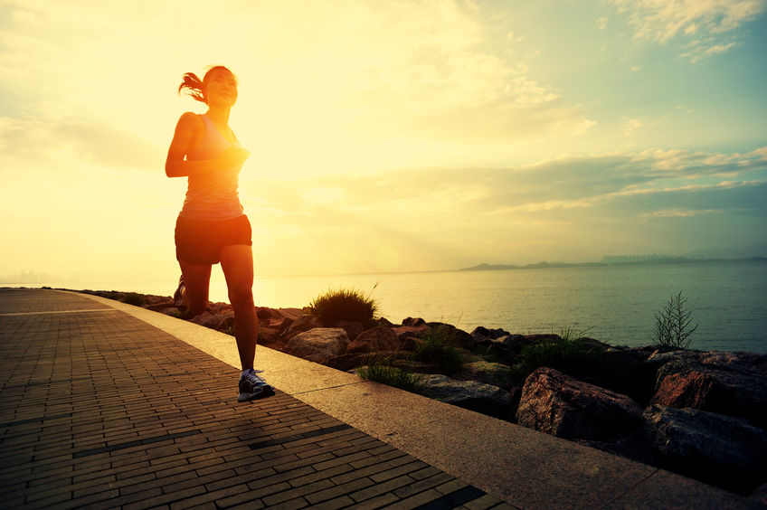 Woman running sunset