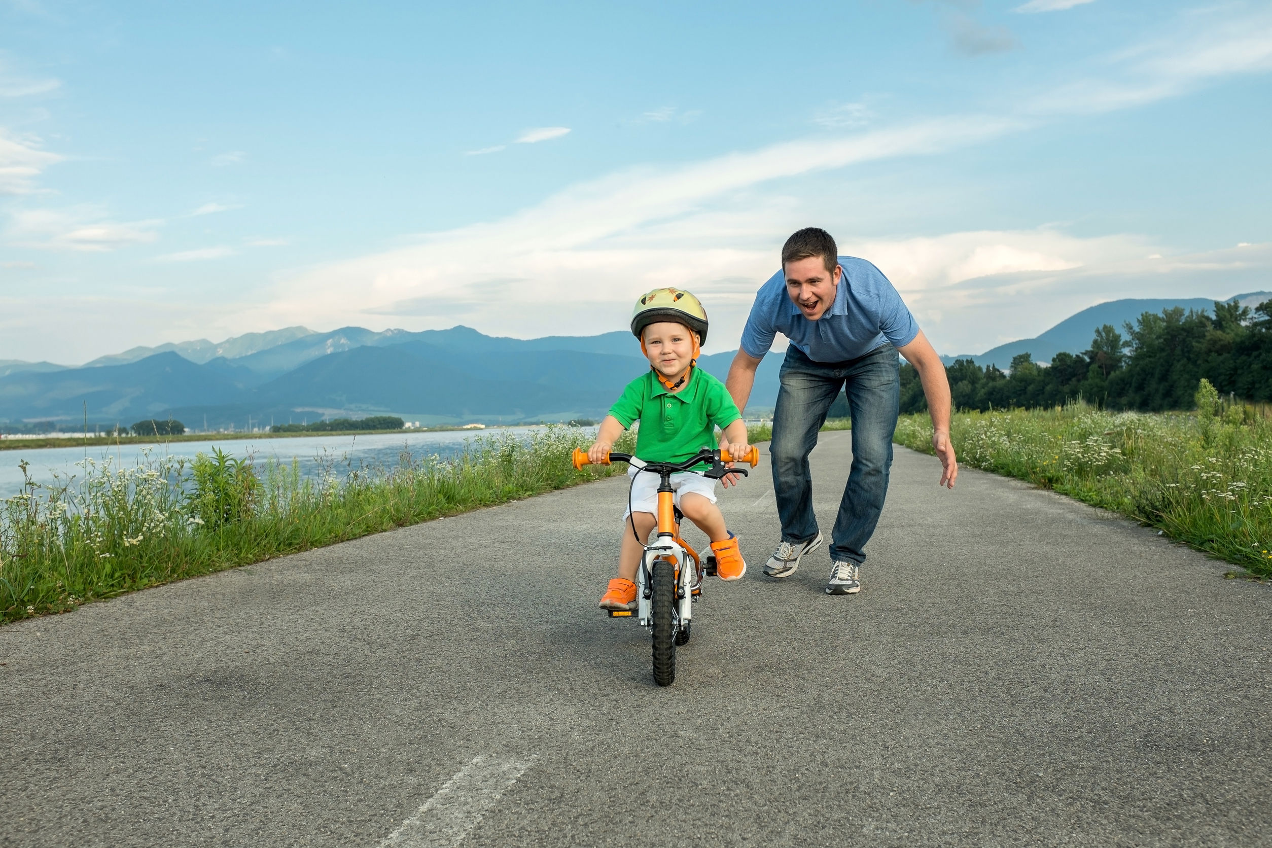 37279314 - happiness father and son on the bicycle outdoor