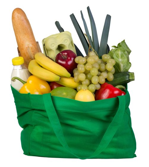 29947984 - groceries in a green bag isolated on white background